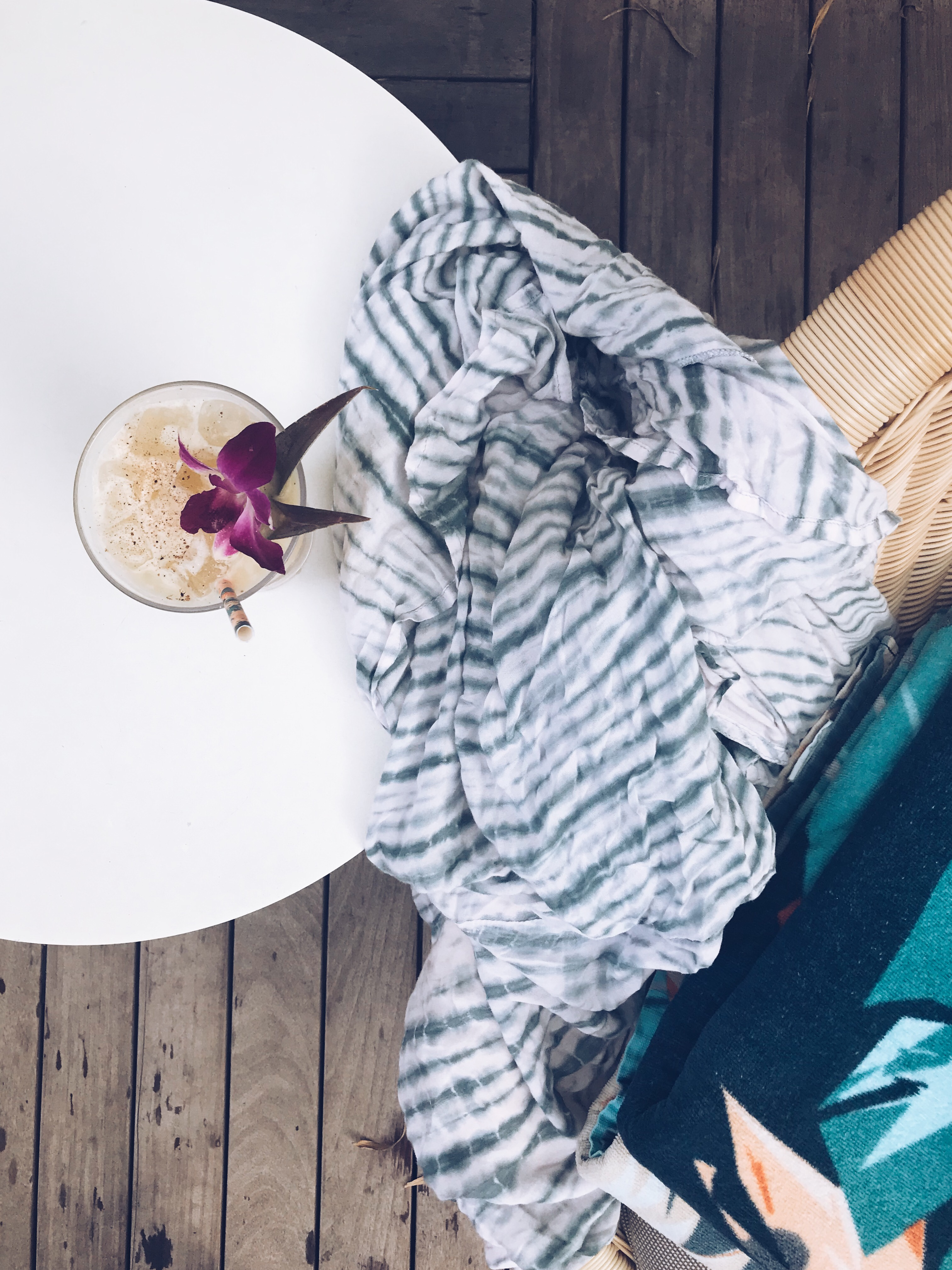Umbrella drink, towels and sarong.
